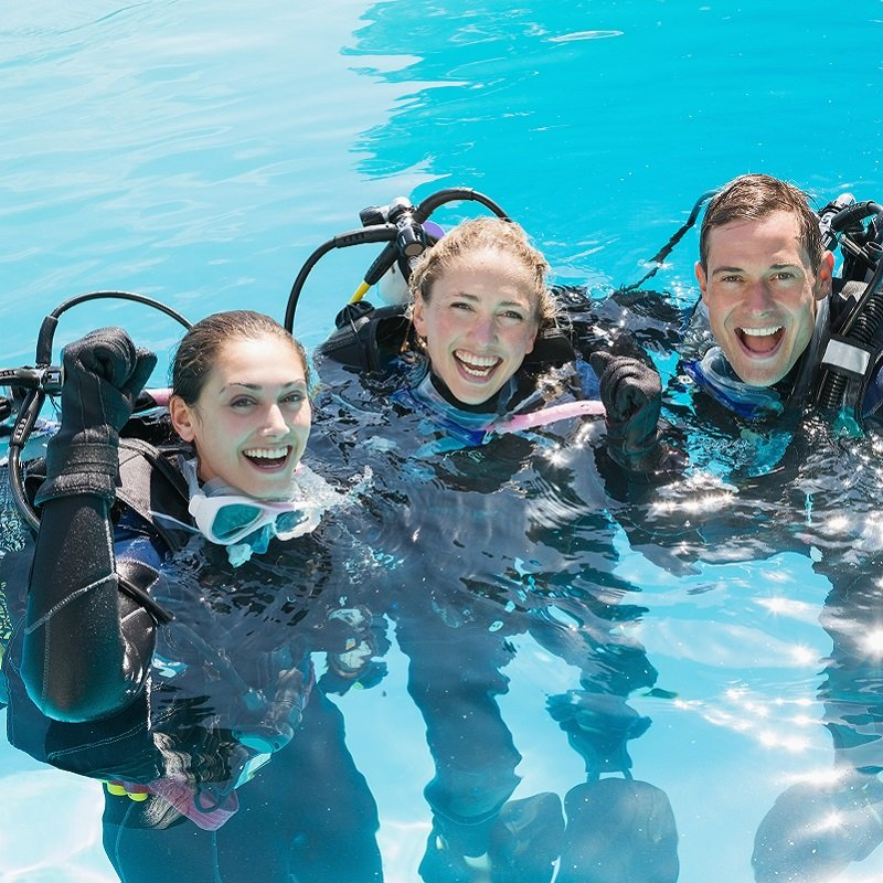scuba class smiles for camera